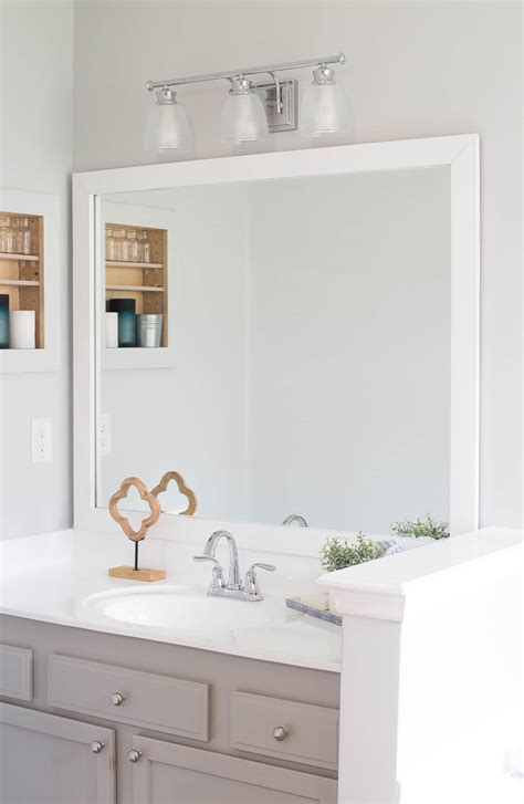 Framed Bathroom Mirrors Diy by How To Frame A Bathroom Mirror Easy Diy Project