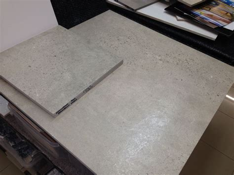 polished concrete look floor tiles for back rumpus area