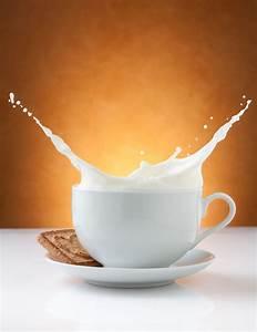 Cup Of Milk Splash With Biscuit