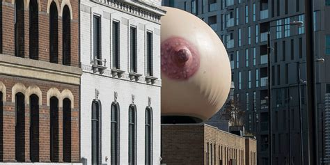 mother london put  giant boob  top   building