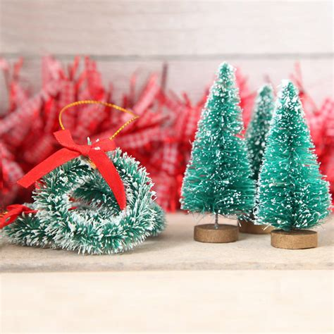 eight mini christmas tree and wreath decorations by red