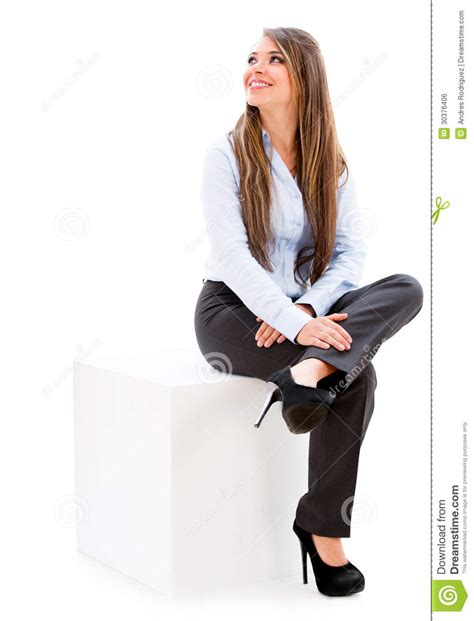 For Sitting by Businesswoman Sitting On A Cube Stock Photo Image Of
