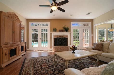 Living Room With Fireplace And Doors living room doors with fireplace between