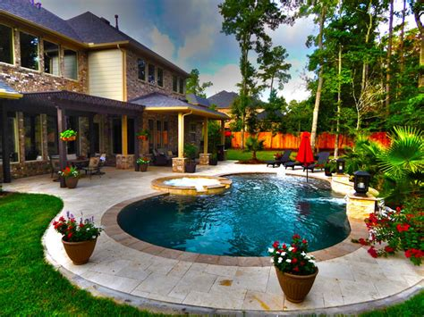 pool with pergola curved pool with fountain and pergola contemporary pool houston by absolutely outdoors