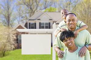 African American Family In Front Of Blank Real Estate Sign ...