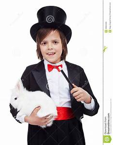 Young Magician Boy Holding White Rabbit Stock Photo ...