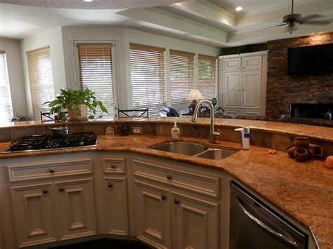 kitchen island with cooktop and seating kitchen kitchen island with sink and dishwasher kitchen