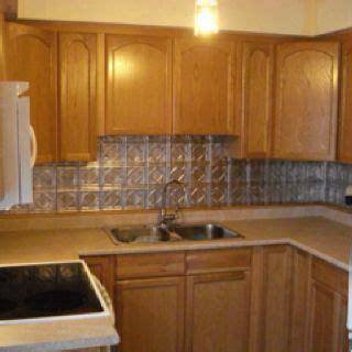 kitchen backsplash with oak cabinets punched tin backsplash with oak stained cabinets 7715