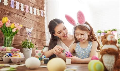 Happy Easter! A Mother And Her Daughter Painting Easter