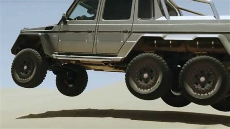 Only the middle of the three pairs of wheels are powered, sadly. 2014 mercedes G 63 AMG 6 wheel truck commercial-Mercedes ...