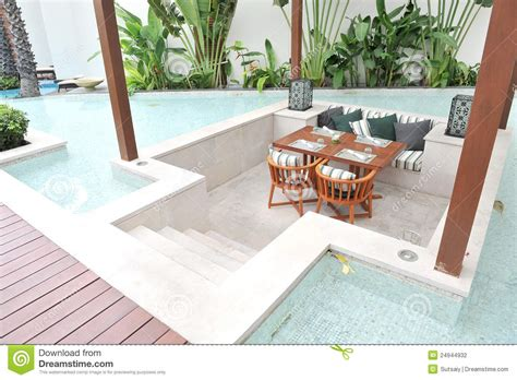 table and chairs in pool stock photography image 24944932