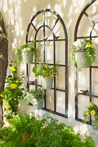 the shape of these wall planters matches that of the With patio wall decor