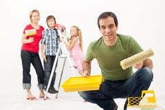 Happy Family Redecorating The House  Painting Stock Photo