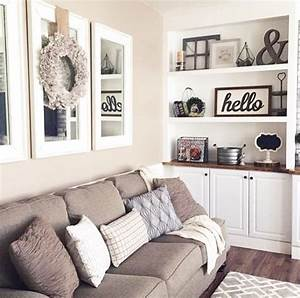 mirrors above couch with wreath open the room up with With kitchen cabinets lowes with large wall art for family room