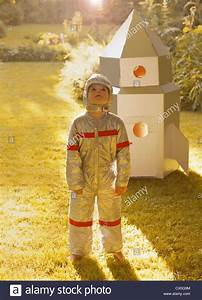Boy Wearing Space Suit Standing in front of Cardboard ...