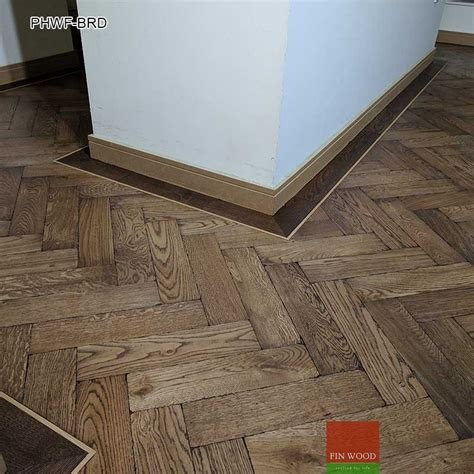 Parquet Herringbone wood flooring with border