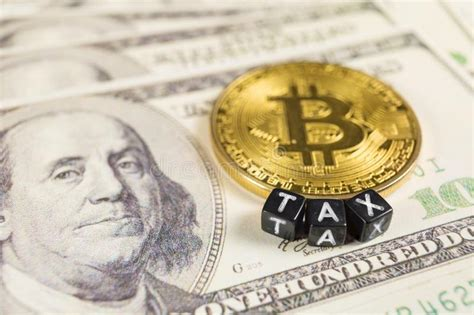 Bitcoin has defied financial gravity in 2017 but, in one respect, its just like any other investment: Bitcoin Tax Concept On Dollar Bills Stock Image - Image of crypto, deadline: 143738245