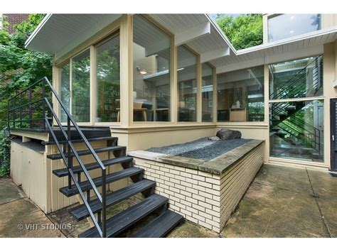 story mid century modern cedar brick home