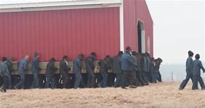 Watch As 250 Amish Men Pick Up A Barn And Carry It Across