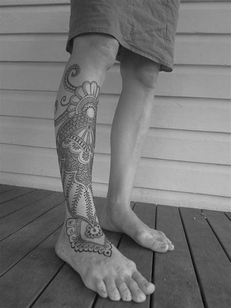 Lace and black octopus tattoo on leg