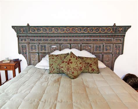 antique indonesian headboard eclectic bedroom orange