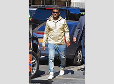 Usher steps out wearing gold jacket in NYC but leaves
