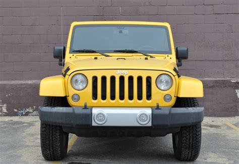 yellow jeep wrangler unlimited jeep wrangler unlimited sahara 2015 suv drive