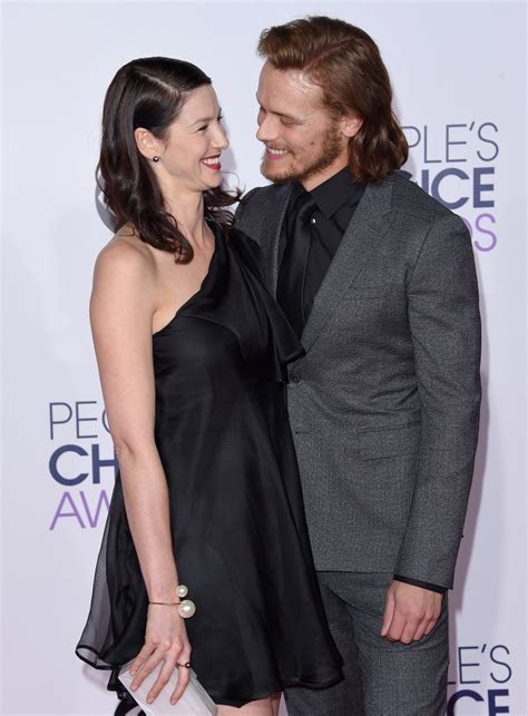 tobias menzies wdw sam heughan and caitriona balfe photos arrivals at the