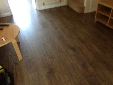 how to care for hardwood floors in kitchen laminate flooring laminate flooring heavy duty 9700