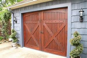 love the barn style garage door for the home With barn type garage doors