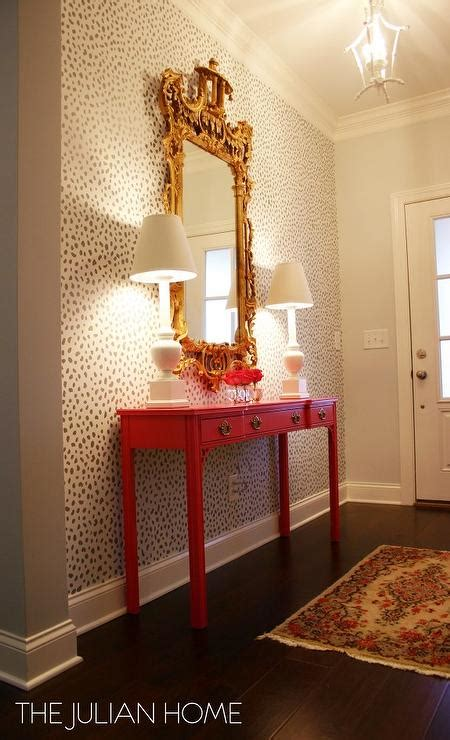 stenciled foyer wall  hot pink console table