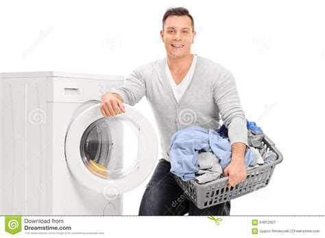 doing laundry by content young man doing laundry stock photo image 64912927