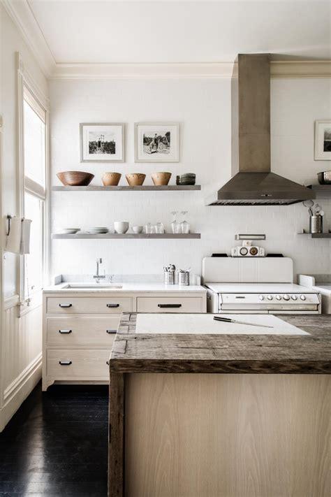floating shelves natural wood island  white subway tile backsplash wall  country kitchen