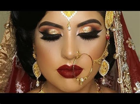 real bride asian bridal traditional makeup dramatic bold winged eyes  dark red lipstick