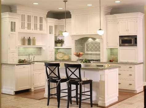 White Kitchen With Bead Board And Green Tile Backsplash