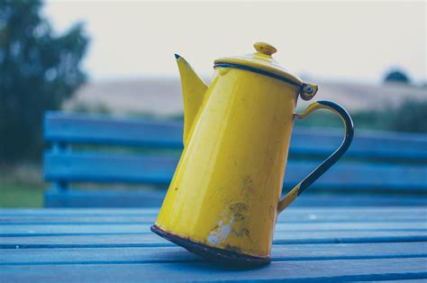 teapot coffee table pour pot kettle tipping yellow bird drink macro wooden pxhere
