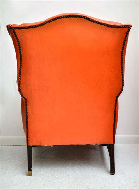 vintage orange leather wing chair at 1stdibs