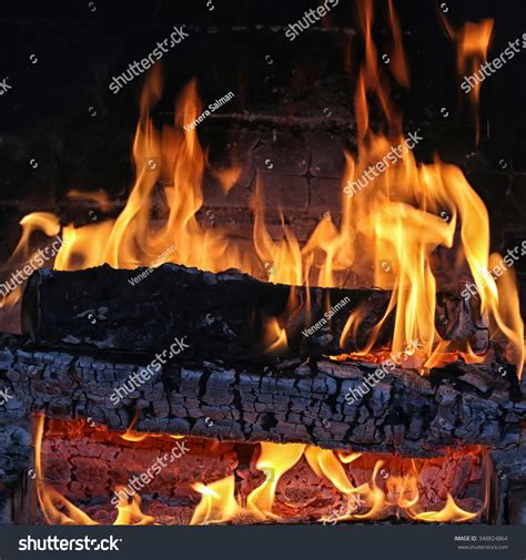 Macro Texture Flame From The Burning Logs In The Fireplace