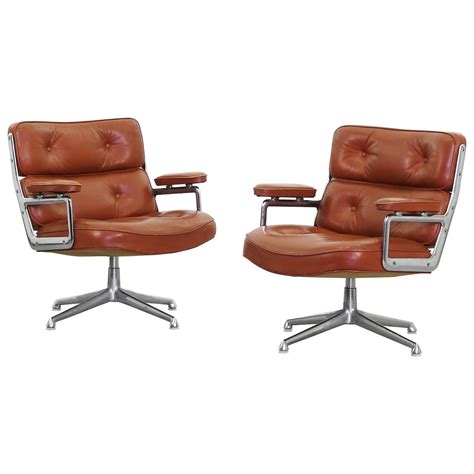 pair of lounge lobby chairs es105 by charles eames for