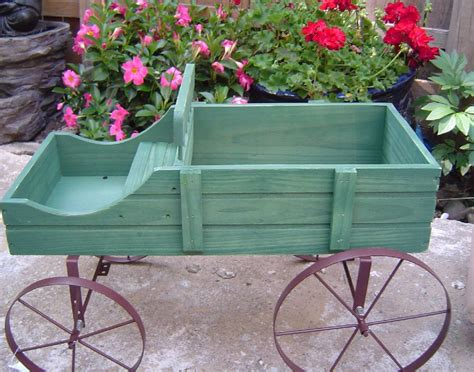 green wood wagon rolling amish country cart flower plant