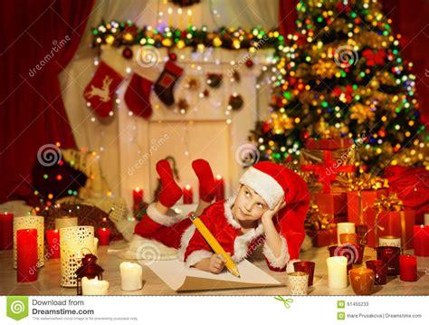 christmas kid write  list child santa hat writing