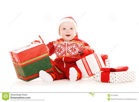 santa helper baby with christmas gifts stock photo image