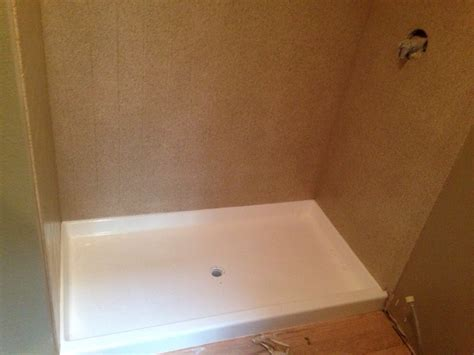 tile walls around the shower base were refinished with our