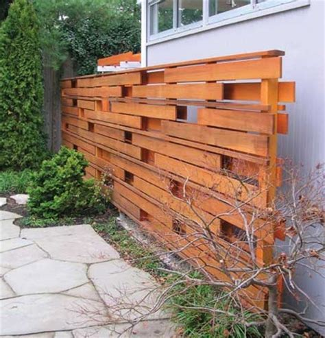 decorative wood fencing ideas random board fence decorative and functional use all that leftover wood fences trellises