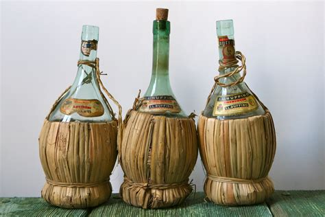 vintage chianti wine bottles with straw bases
