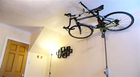 Ceiling Bike Rack Flat by Stowaway Stashes Your Bike On The Ceiling To Free Up Space