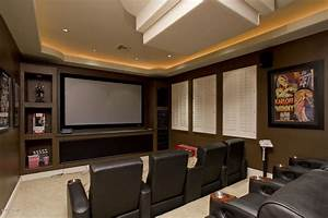 Modern Home Theater with Cove lighting & Built