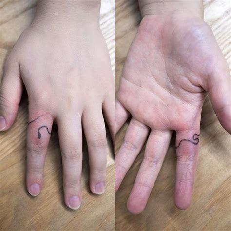 hand poked snake tattoo   finger