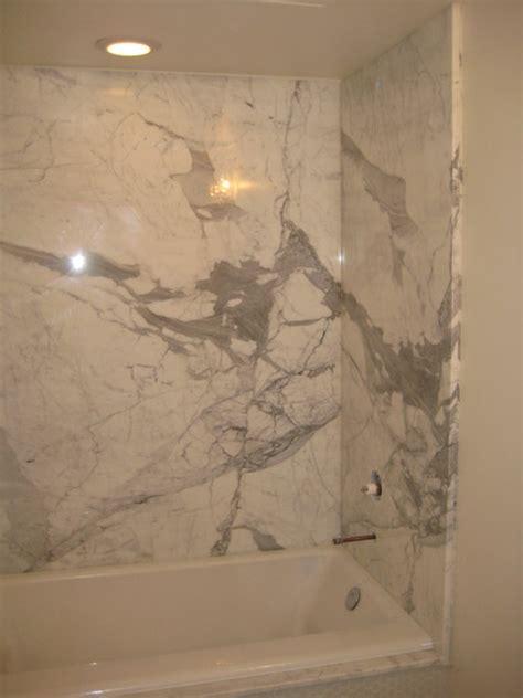 Bathroom Shower: Calcutta Gold marble slabs   Modern   New Orleans   by LaBruyere Stone