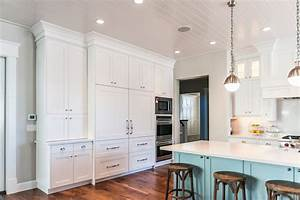 Concealed refrigerator kitchen benjamin moore white for What kind of paint to use on kitchen cabinets for blue heron wall art